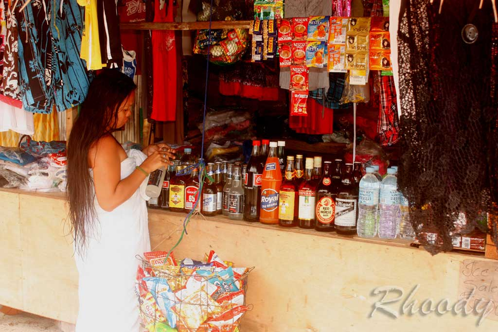 Rechel Serone checking her Tanduay Ice in Moalboal